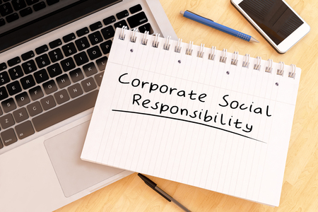 business roles: Corporate Social Responsibility - handwritten text in a notebook on a desk - 3d render illustration. Stock Photo