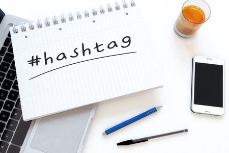 Hashtag - handwritten text in a notebook on a desk - 3d render illustration.