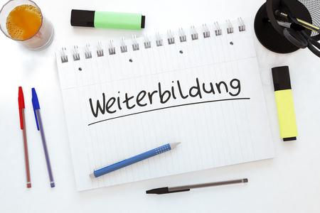 further: Weiterbildung - german word for further education - handwritten text in a notebook on a desk - 3d render illustration.