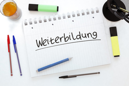Weiterbildung - german word for further education - handwritten text in a notebook on a desk - 3d render illustration.