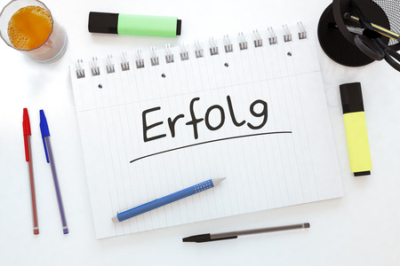 Erfolg - german word for success - handwritten text in a notebook on a desk - 3d render illustration. Stock Photo