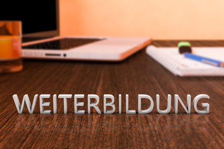 further education: Weiterbildung - german word for further education - letters on wooden desk with laptop computer and a notebook. 3d render illustration.