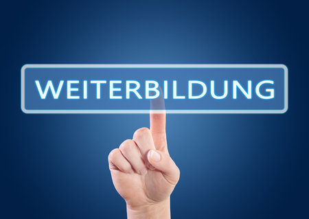 further education: Weiterbildung - german word for further education - hand pressing button on interface with blue background. Stock Photo