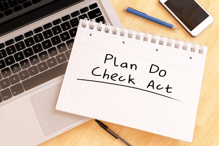 plan do check act: Plan Do Check Act - handwritten text in a notebook on a desk - 3d render illustration.