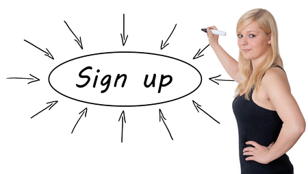 Sign up - young businesswoman drawing information concept on whiteboard. photo