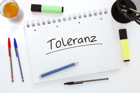 tolerancia: Toleranz - german word for tolerance - handwritten text in a notebook on a desk - 3d render illustration.