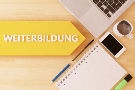 further education: Weiterbildung - german word for further education - linear text arrow concept with notebook, smartphone, pens and coffee mug on desktop. Stock Photo