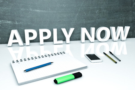 Apply now - text concept with chalkboard, notebook, pens and mobile phone. 3D render illustration. Stock Photo