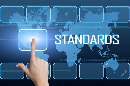 standardization: Standards concept with interface and world map on blue background Stock Photo