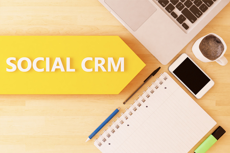 busines: Social CRM - linear text arrow concept with notebook, smartphone, pens and coffee mug on desktop - 3d render illustration. Stock Photo