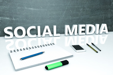wikis: Social Media - text concept with chalkboard, notebook, pens and mobile phone. 3D render illustration. Stock Photo