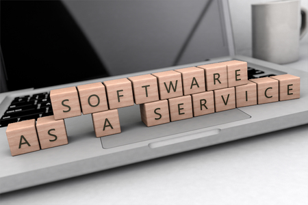Software as a Service - wooden letters on notebook computer - 3d render illustration.