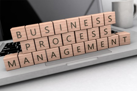 Business Process Management - wooden letters on notebook computer - 3d render illustration.