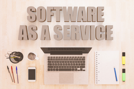 Software as a Service - text concept with notebook computer, smartphone, notebook and pens on wooden desktop. 3D render illustration. 版權商用圖片 - 90015306