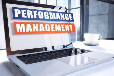 Performance Management text on modern laptop screen in office environment. 3D render illustration business text concept.