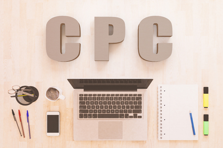 CPC - Cost per Click - text concept with notebook computer, smartphone, notebook and pens on wooden desktop. 3D render illustration.