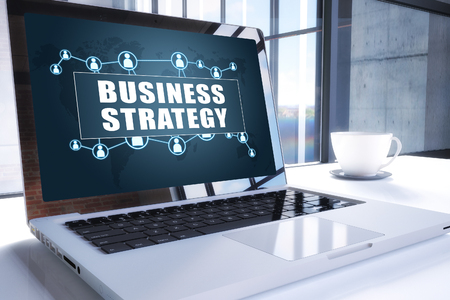 Business Strategy text on modern laptop screen in office environment. 3D render illustration business text concept.