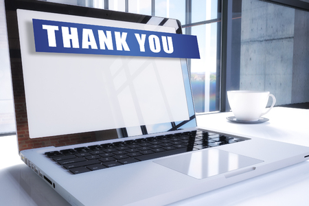 Thank you text on modern laptop screen in office environment. 3D render illustration business text concept.