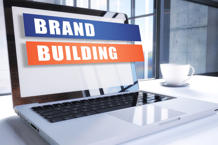 Brand Building - text on modern laptop screen in office environment. 3D render illustration business text concept. 写真素材