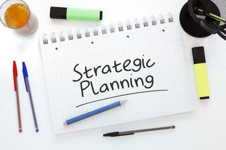Strategic Planning - handwritten text in a notebook on a desk - 3d render illustration.