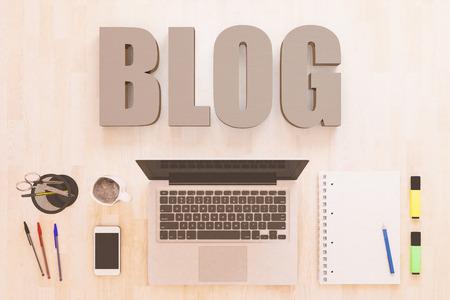 Blog - text concept with notebook computer, smartphone, notebook and pens on wooden desktop. 3D render illustration. 写真素材