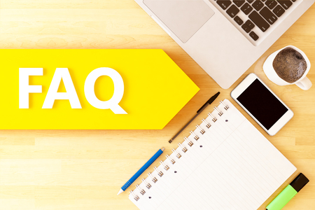 FAQ - Frequently Asked Questions - linear text arrow concept with notebook, smartphone, pens and coffee mug on desktop - 3D render illustration. 写真素材