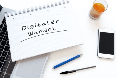 Digitaler Wandel - german word for digital change or digital business transformation  - handwritten text in a notebook on a desk - 3d render illustration. 写真素材