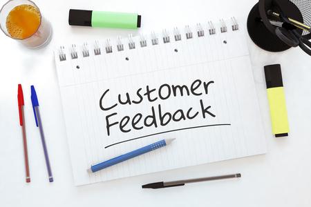 Customer Feedback - handwritten text in a notebook on a desk - 3d render illustration.