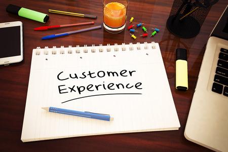 Customer Experience - handwritten text in a notebook on a desk - 3d render illustration. 写真素材