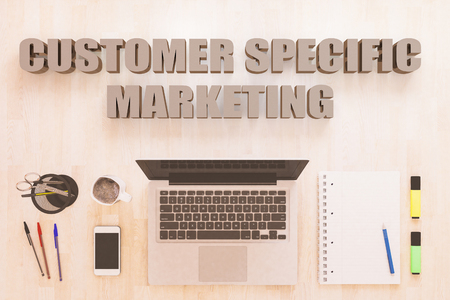 Customer Specific Marketing - text concept with notebook computer, smartphone, notebook and pens on wooden desktop. 3D render illustration. 写真素材