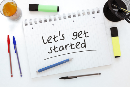 Lets get started - handwritten text in a notebook on a desk - 3d render illustration.