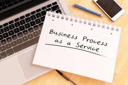 Business Process as a Service - handwritten text in a notebook on a desk - 3d render illustration.
