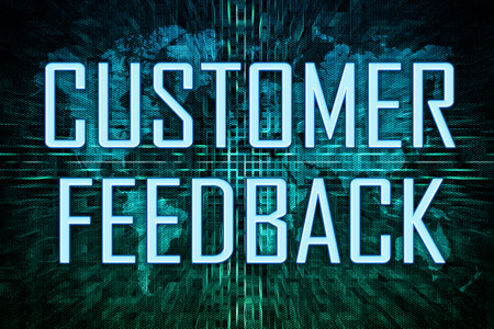 Customer Feedback text concept on green world map background.