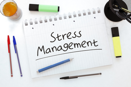 Stress Management - handwritten text in a notebook on a desk - 3d render illustration.