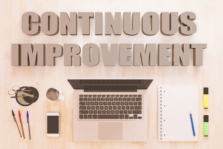 Continuous Improvement - text concept with notebook computer, smartphone, notebook and pens on wooden desktop. 3D render illustration.