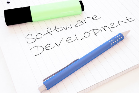 Software Development - handwritten text in a notebook on a desk - 3d render illustration. 写真素材
