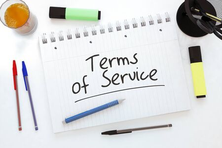 Terms of Service - handwritten text in a notebook on a desk 写真素材