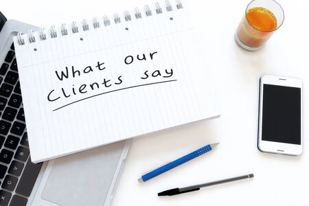 What our Clients say - handwritten text in a notebook on a desk
