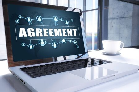 Agreement text on modern laptop screen in office environment. 写真素材 - 128059592