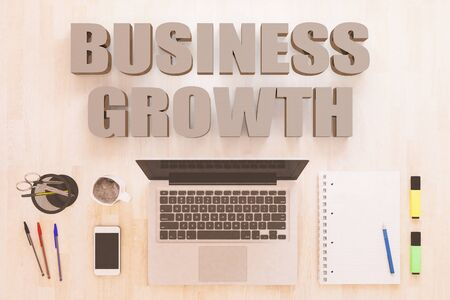 Business Growth - text concept with notebook computer, smartphone, notebook and pens on wooden desktop. 写真素材