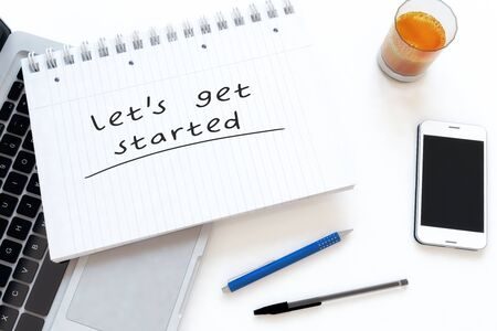 Lets get started - handwritten text in a notebook on a desk