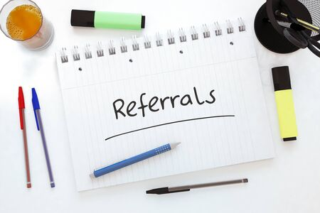 Referrals - handwritten text in a notebook on a desk 写真素材 - 128060146