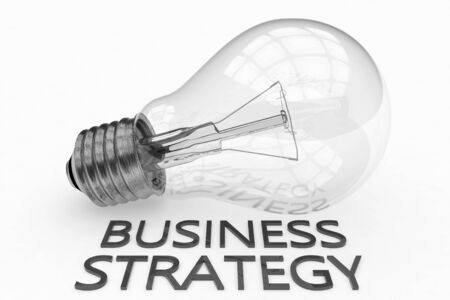 Business Strategy - light bulb on white  with text under it. 写真素材 - 128059924