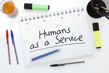 Humans as a Service - handwritten text in a notebook on a desk 写真素材