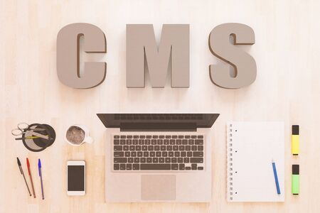 CMS - Content Management System - text concept with notebook computer, smartphone, notebook and pens on wooden desktop. 写真素材 - 128059781