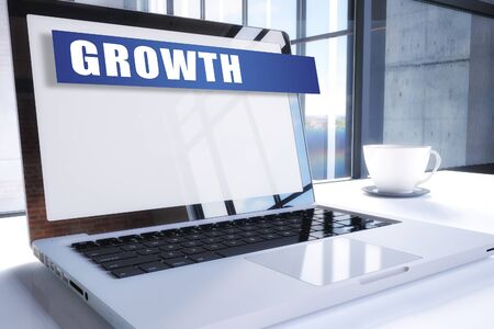 Growth text on modern laptop screen in office environment. 写真素材 - 128059682