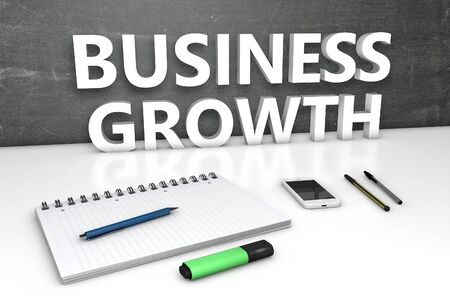 Business Growth text with chalkboard, notebook, pens and mobile phone.