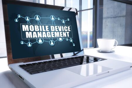 Mobile Device Management text on modern laptop screen in office environment.