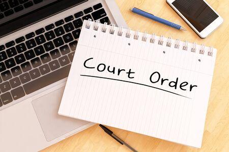 Court Order handwritten text in a notebook on a desk