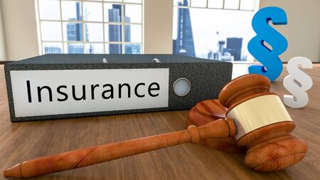Insurance text on file folder with court hammer and paragraph symbols on a desk